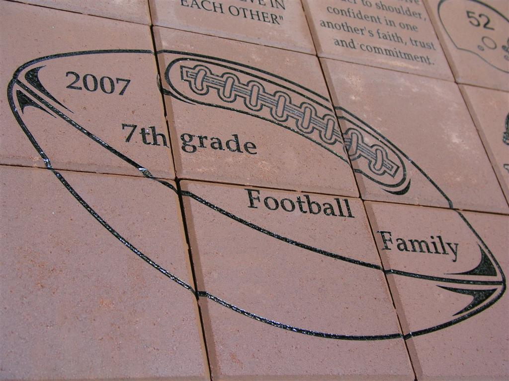 """Laser Engraved Logo Array on 8""""x8"""" Brick Pavers Supporting Athletics"""